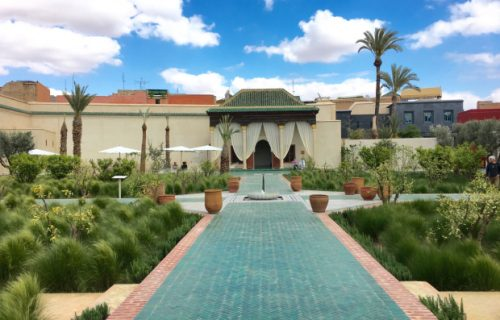 Traditional Islamic green tiles lead to a central water feature at Le Jardin Secret